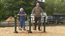 Pensioners playing on the play equipment.