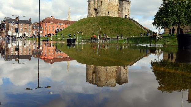 Cliffords Tower, one of York&#x27;s famous ancient attractions is reflected in flood water 