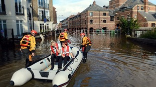Fire Brigade crews from York take care staff to a residential home by boat