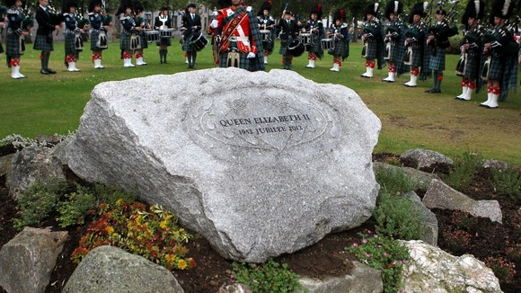 A pipe band stand behind the Ballater Jubilee Cairn, in Ballater, Aberdeenshire