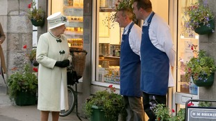 The Queen talks to the local butchers, in Ballater