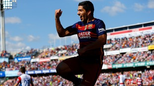 Suarez nets hat-trick as Barcelona retain La Liga title