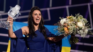 Waving the glass microphone in the air, the 32-year-old singer said, 'Thank you Europe - welcome to Ukraine.'