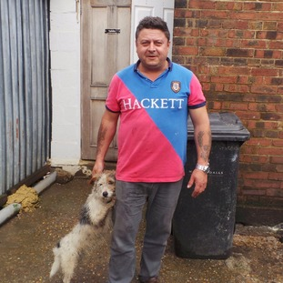 Owner John Pedro with Russell the dog.
