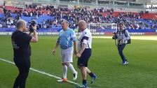 Captains Tony Kelly and John McGinlay leave the pitch after the match.