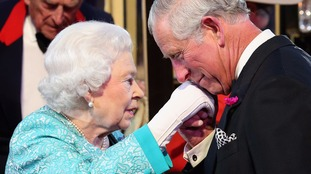 The heir to the throne kissed his mother on her gloved hand