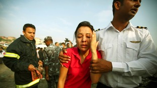 A woman cries at the crash site in Kathmandu.