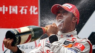 The racer celebrates winning the Formula One World Drivers' Championship (WDC) in 2008 with McLaren.