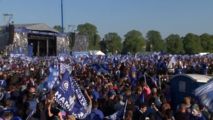 The crowds are awaiting the players to come on stage with the Premier League trophy