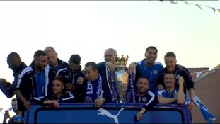 The Leicester City players are celebrating their Premier League triumph with an open-top bus tour through the city.