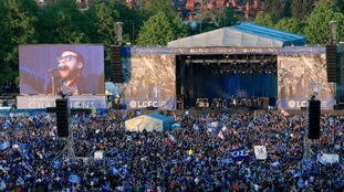 Kasabian perform on stage in Victoria Park after the open top bus parade through Leicester City Centre.