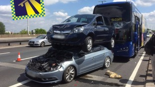 Car left crumpled on roof after six-vehicle pile up