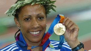Britain's Kelly Holmes displays her gold medal in the women's 800 metres at the Athens 2004 Olympics