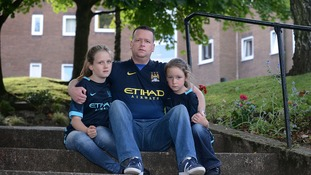 Paul Longden with his two young daughters