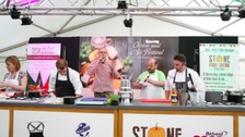 A demonstration involving chefs in the food tent