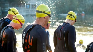 Swimmers entering the water at Ragley Hall at the Open Water Festival