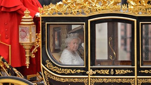 The Queen and Prince Philip in the royal carriage.