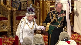 The Queen departed the chamber with the help of the Duke of Edinburgh.
