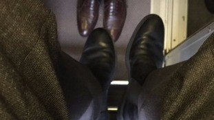 Passengers sit in luggage racks as strike hits hundreds of rail services
