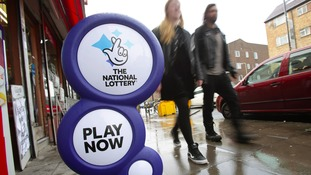 The National Lottery sign outside a newsagent