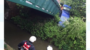 Woman rescued from car which was left hanging over canal