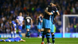Sheffield Wednesday's Atdhe Nuhiu and Fernando Forestieri (right) celebrate after the final whistle during the Sky Bet Championship play off, second leg match at the AMEX Stadium, Brighton.
