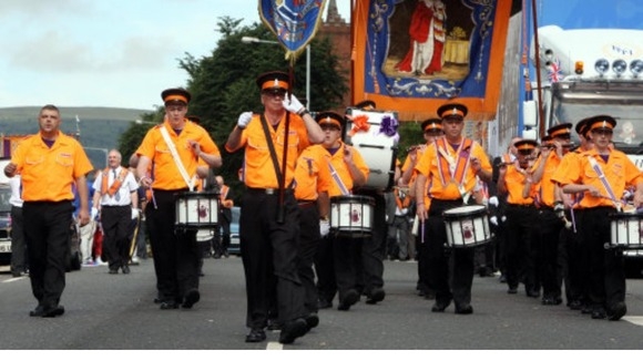 Orange Order bandsmen on the march in Belfast, in July