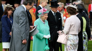 The Queen and Duke of Edinburgh chat to guests at the garden party