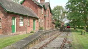 Converted railway station for sale - and it comes with its own train and track