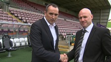 Rob Page (right) shakes hands with Cobblers chairman Kelvin Thomas.