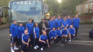 Morpeth Town with team bus and 'Steve' the Highwayman