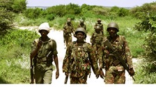 A team of Kenyan Defence Forces and Somali Transitional Federal Government soldiers patrol the Indian Ocean coastline