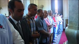 Men say prayers in a mosque in Cairo