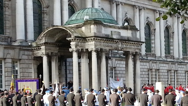 The Belfast City hall surrounded by Orange Order members