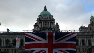 The Union Flag is raised over Belfast's City Hall