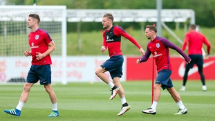 England's Jamie Vardy (centre), Daniel Drinkwater (right) and Gary Cahill during the training session at St George's Park, Burton.