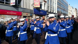 Marchers in the Ulster Covenant parade marching down Belfast's city centre