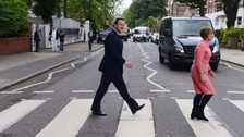 David Cameron and Tessa Jowell walk on the famous zebra crossing outside Abbey Road Studios