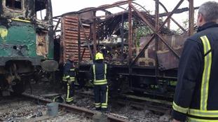 Firefighters survey damage
