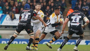 Wasps' Siale Piutau (second right) tries to get past the Exeter Chiefs defence.
