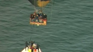 Nine passengers were rescued from a hot air balloon by a passing boat