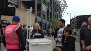 Supporters buying programmes
