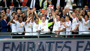 Manchester United Captain Wayne Rooney lifts the FA Cup