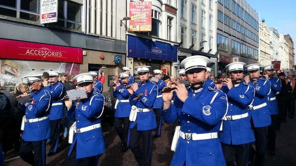 Marchers in the Ulster Covenant parade down Belfast's city centre