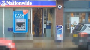 A quick-thinking member of the public captured footage on his mobile phone of two robbers making off from the scene of an attempted robbery