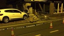 Man arrested after car crashes into dental surgery