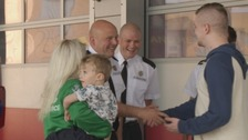 The family meet the firefighters who saved their lives