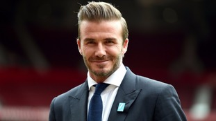 Beckham spotted handing burger and beer to homeless man.