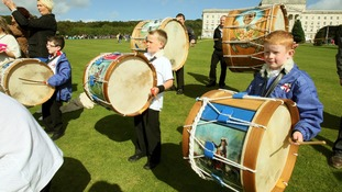 Young Lambeg drummers welcomed Orange Order members as they arrived at Stormont in Belfast.