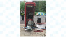 Phone box blown apart as thieves try to steal cash machine inside